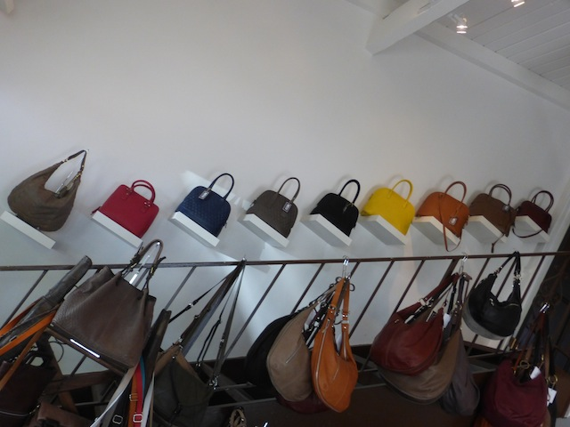 Gramercy store with a selection of colorful leather handbags and accessories in Studio City.