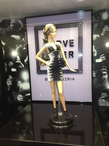 Barbie Doll by Max Azria wears the official Herve Leger black and white jacquard bandage dress available at Herve Leger boutiques.