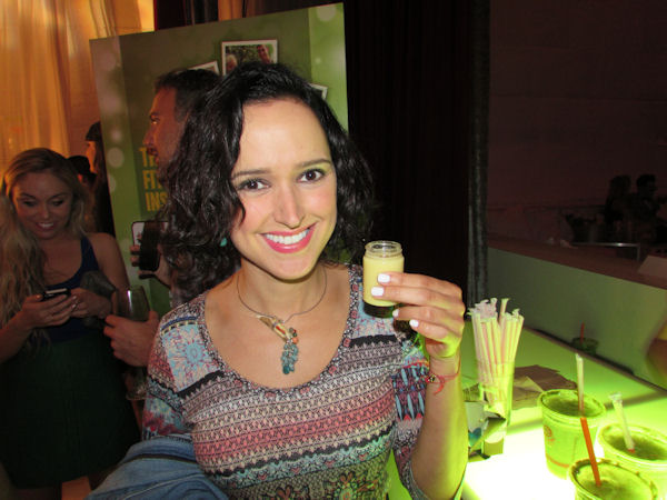 Actress Elizabeth Lazo at the Star Magazine Hollywood Rocks Party holding a Jamba Juice shot of Ginger