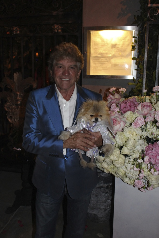 Ken Todd Poses with his dog at the Pump Restaurant and Lounge Opening Party in West Hollywood on May 13, 2014