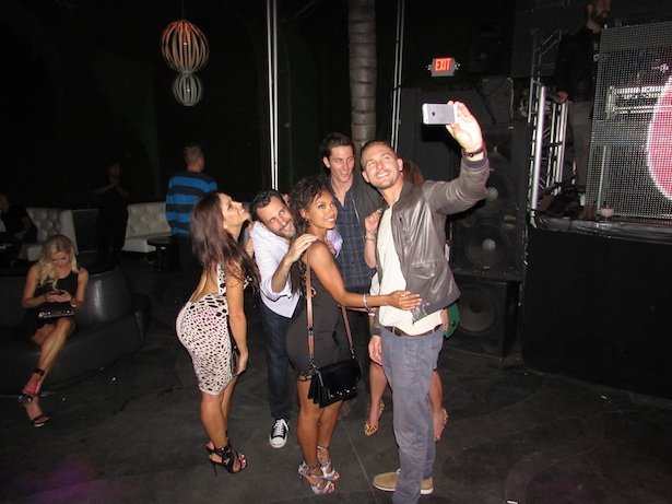 OK! Magazine's So Sexy Party Actor Adam Senn taking a last minute Selfie with Actress Logan Browning and guests