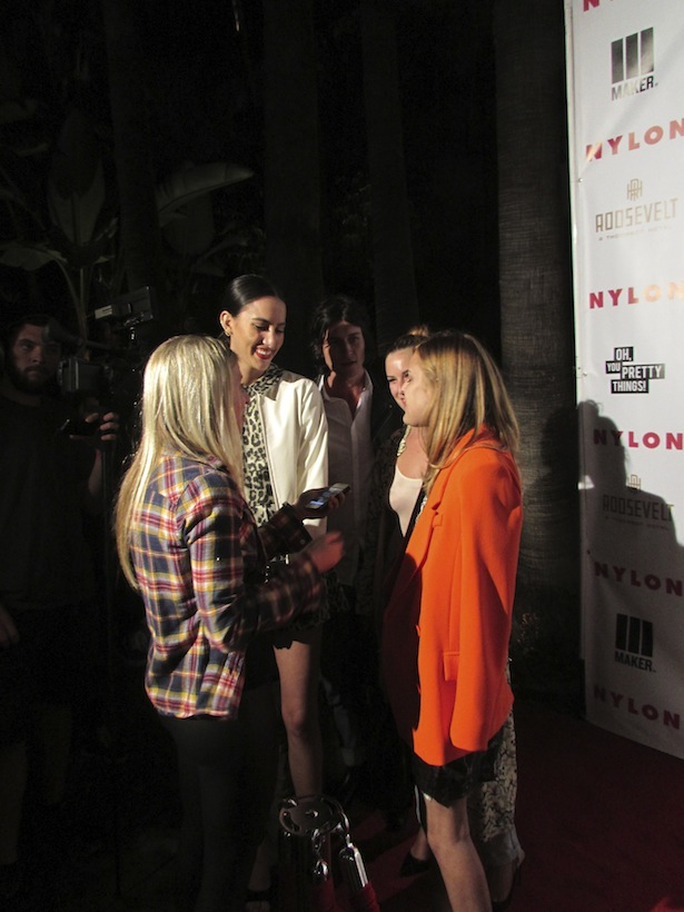 Sisters Tallulah Willis and Scout Willis hanging out at the Nylon Magazine Young Hollywood Party at Hollywood Roosevelt Hotel