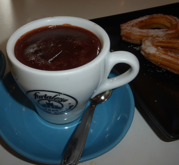 Chocolate Dipping Sauce served in a cup with Churros: Travel Food Diary Spain