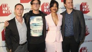 "LOS ANGELES, CA - NOVEMBER 18: Director of photography Mike Sierakowski, director Andrew Jenks, MAC Viva Glam Spokesperson Rihanna and filmmaker Bruce Bohman attend MAC Cosmetics And MAC AIDS Fund World Premiere Of ""It's Not Over"" Film Directed By Andrew Jenks on November 18, 2014 in Los Angeles, California."