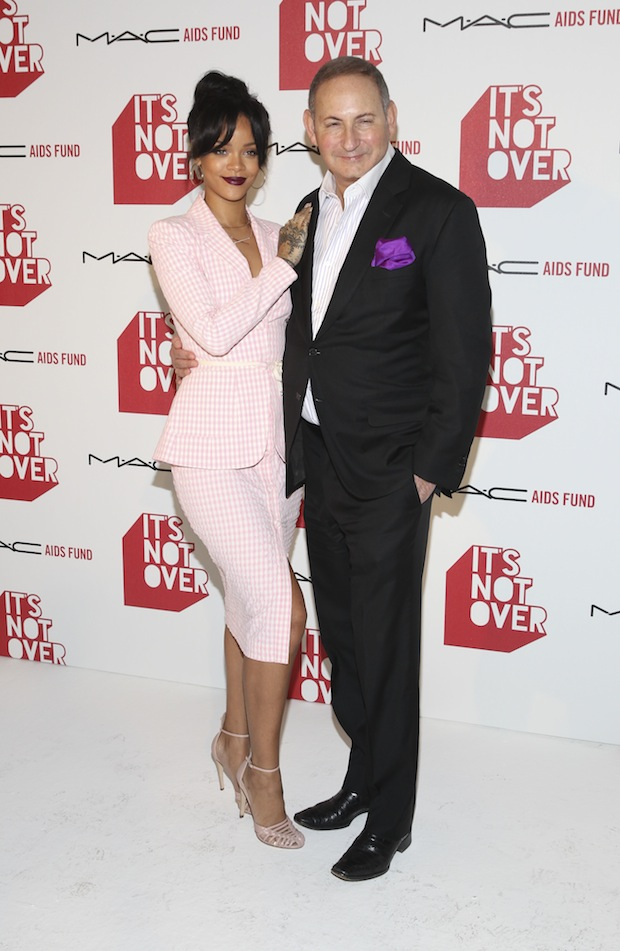 "MAC Viva Glam Spokesperson Rihanna and Chairman of the MAC AIDS Fund and Group President, the Estee Lauder Companies Inc. John Demsey attend MAC Cosmetics and MAC AIDS Fund world premiere of ""It's Not Over"" film directed by Andrew Jenks on November 18, 2014 in Los Angeles, California."